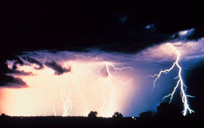 summer thunderstorm with lightning flashing