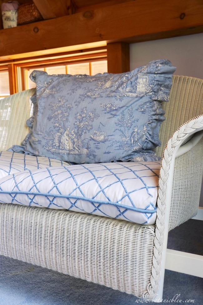 Blue toile is the highlight of a French Country swing loft decorated for summer.
