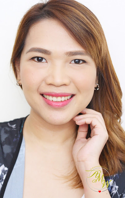 a photo of Nikki Tiu wearing  Laneige Two Tone Lip Bar in Pink Step (No. 6)