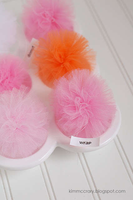 I experimented with multiple ways to make DIY pom poms, but here's the simplest way that created the best pouf.