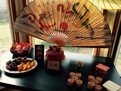 Chinese fan decor, Chinese birthday party, PIn the Eye on the dragon- The Style Sisters