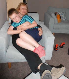 boy sitting on mother