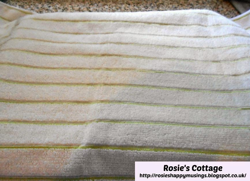 Cover baking paper layer with a clean teatowel