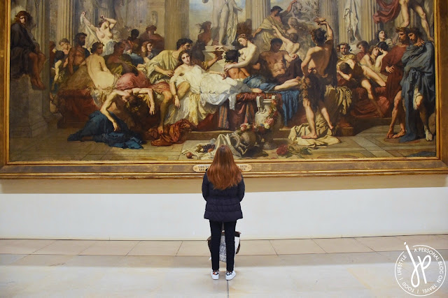 woman looking at huge painting