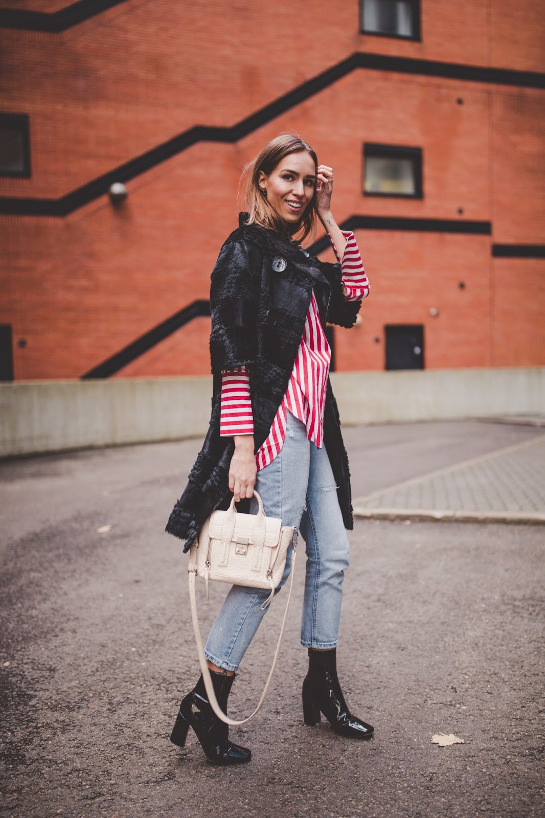 black fur coat stripe shirt jeans minimalist outfit