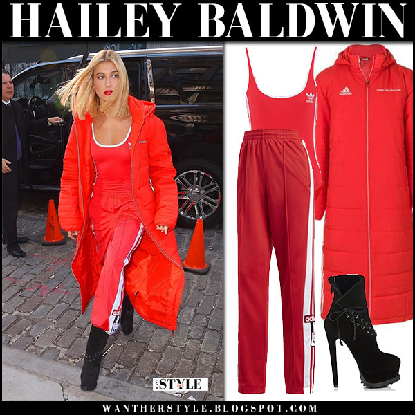 Hailey Baldwin in red long puffer coat gosha rubchinskiy, red adidas track pants and black platform boots alaia model style nyfw