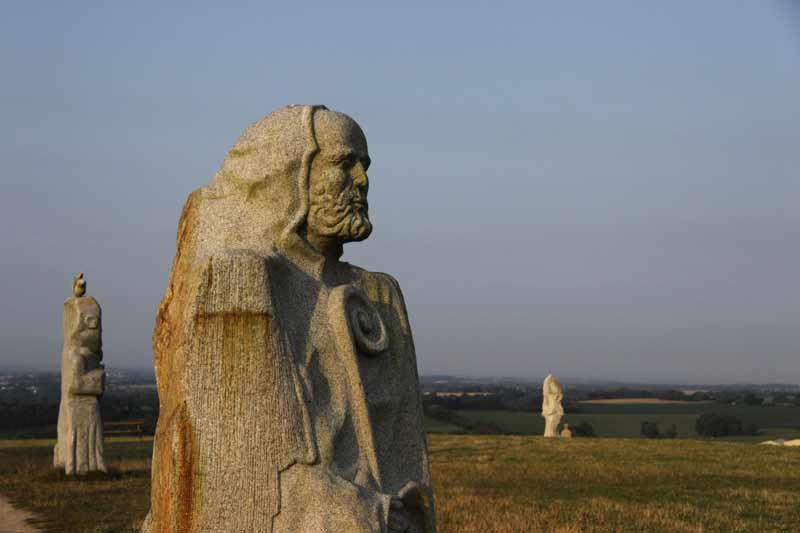 """France is creating its Easter Island with a timeless saga set in stone. Year after year new statues adorn a Breton Hill, are a tribute to the founders of Christianity in this region, from the north come monks, Ireland, Scotland, Wales and Cornwall: St Tugdual, Saint Hernin, St. Gildas, St. Brieuc, St. Malo. Breton that is a project that has gone on for over fifteen years and """"the statues are very much in fifty years."""