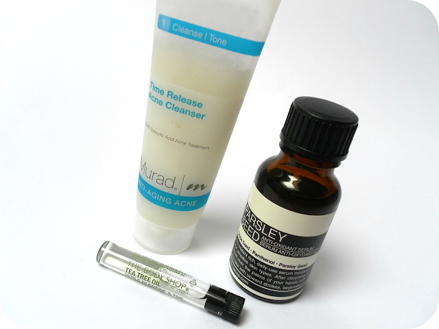 A picture of Murad Time Release Acne Cleanser, AESOP Parsley Seed Anti-Oxidant Serum and The Body Shop Tea Tree Oil