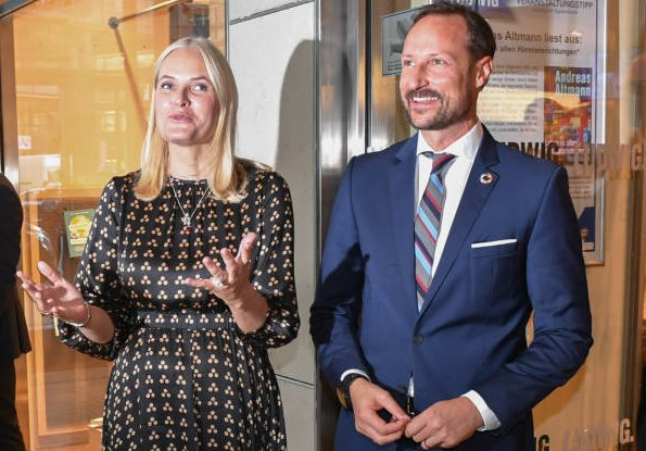 Crown Princess Mette-Marit wore a new satin midi dress by TiMo