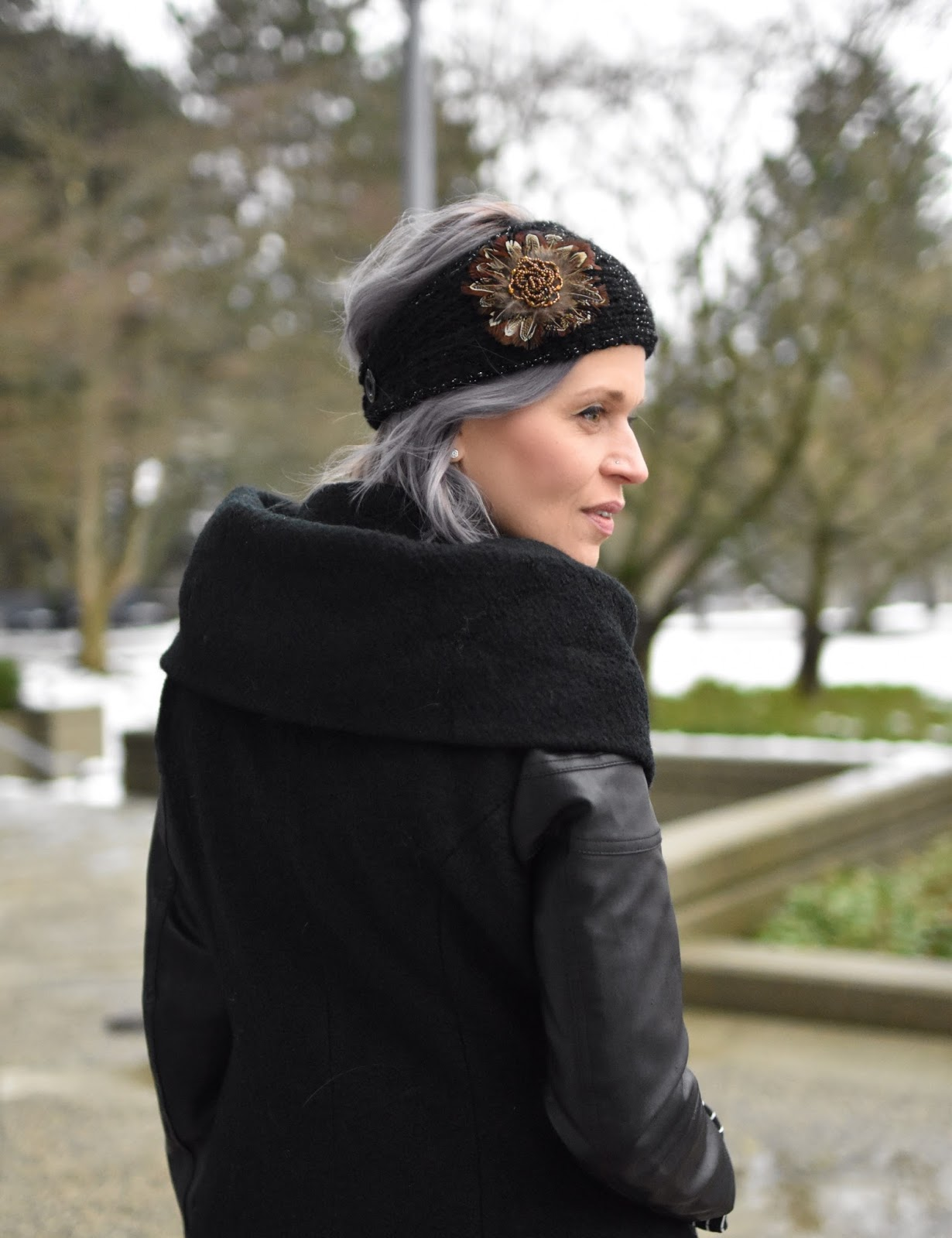 Monika Faulkner outfit inspiration - wool and faux-leather shawl-collar coat, feather-embellished headband