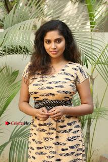 Telugu Actress Karunya Chowdary Stills in Short Dress at ATM Not Working Press Meet  0036.jpg