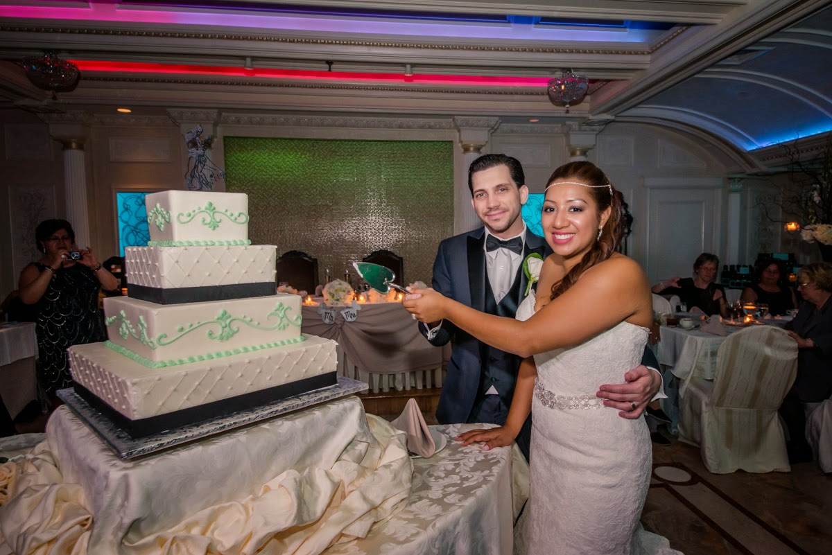 Couple Cutting The Cake