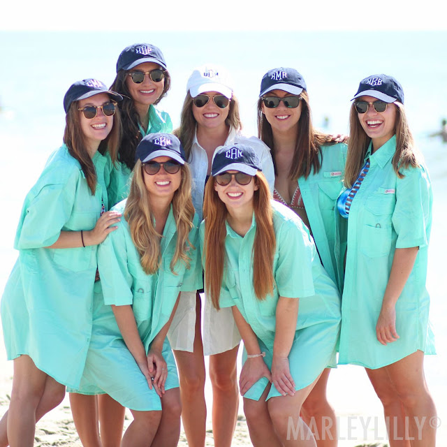 bridal party wearing matching monogrammed fishing shirts
