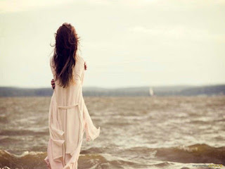Girl-alone-near-sea-waves-sad-forgotten-love-painful-thoughts-image.jpg