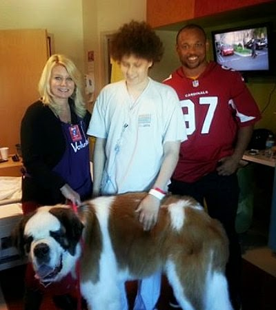 Anthony with Barney, a therapy dog and Lorenzo Alexander of the Arizona Cardinals