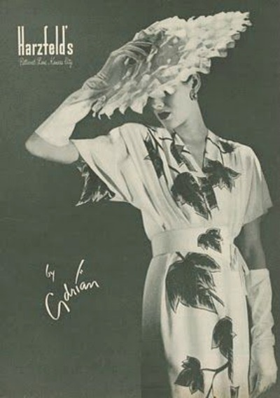 1950s ad for Harzfeld's featuring model in Adrian Dress