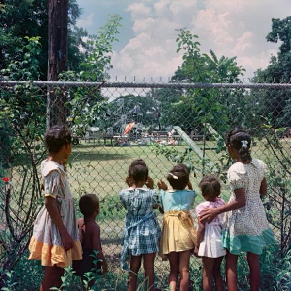 36 Amazing Historical Pictures. #9 Is Unbelievable - Black children watching as white children play in a whites only park (1956)