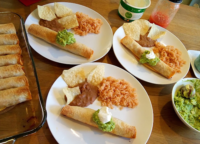 taquitos plate with rice and beans
