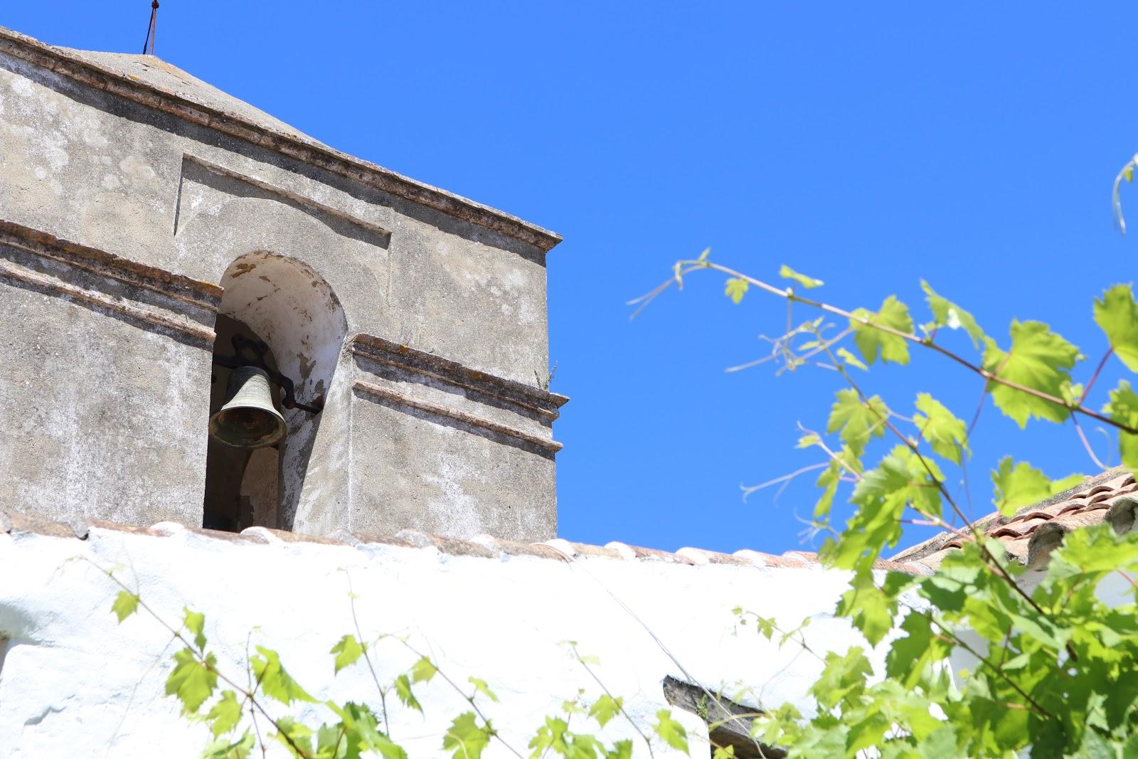 Blue sky against white walls of Castillo de Castellar town