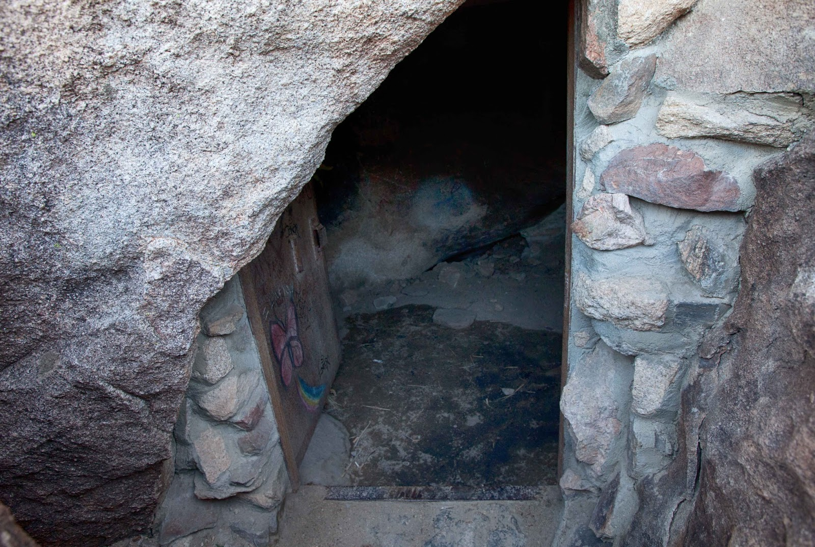 Superb ... The The Rocks Guarding The Entrance, You Can See Rock And Mortar Steps  And The Heavy Iron Door. Bill Keys Put A Lot Of Work Into Building This Cave !!