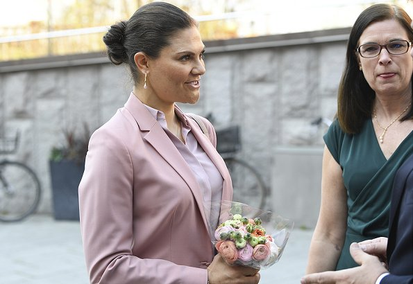 Crown Princess Victoria wore Filippa K blazer and pants. Crown Princess wore a pink pantsuit by Filippa K. Tiger of Sweden Defernex bag