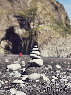a stack of smooth rocks on a beach