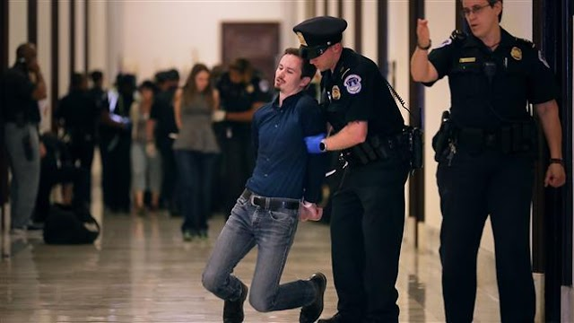 Police detain 80 healthcare bill protesters on US Capitol in Washington, DC