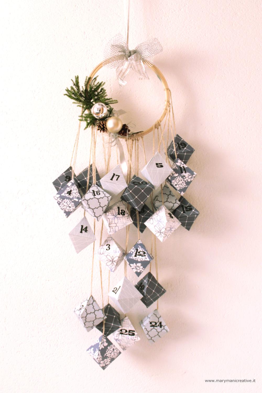 Calendario d'Avvento con diademi di carta origami DIY