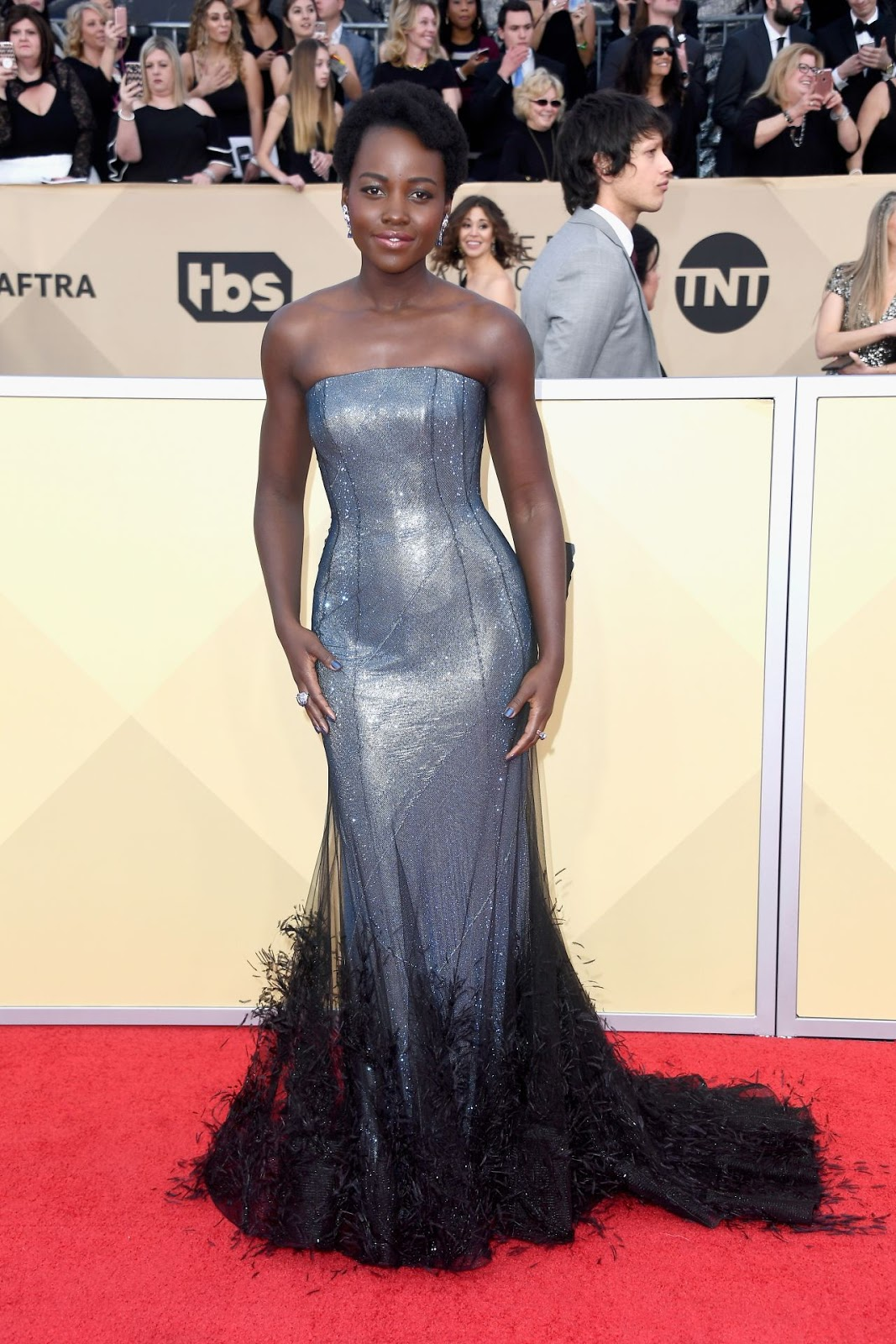 Lupita Nyong'o shimmers in silver at the 2018 SAG Awards