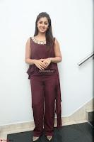 Nikki Galrani in a Brown Shining Sleeveless Gown at Nakshatram music launch ~  Exclusive 104.JPG