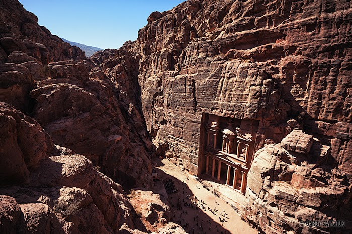 Amazingexplore The path above the royal tombs gives a bird's eye view of the Treasury in Petra, Jordan