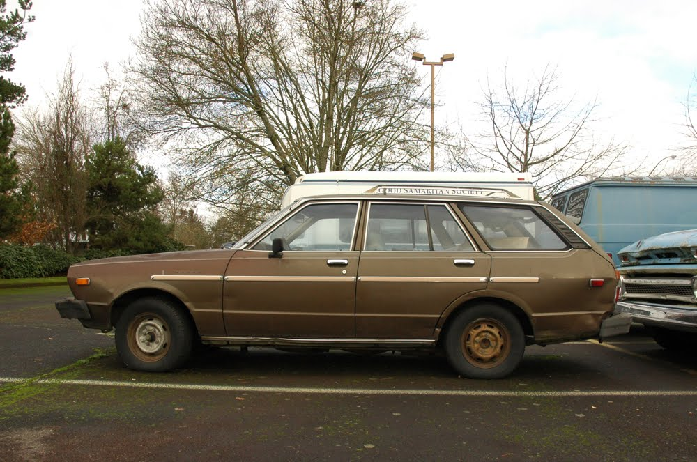 OLD PARKED CARS Eugene Retirement Couple 1980 Datsun 510 Wagon