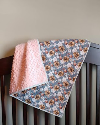 This trendy floral whole cloth quilt with soft minky back is the perfect baby quilt for a girl!