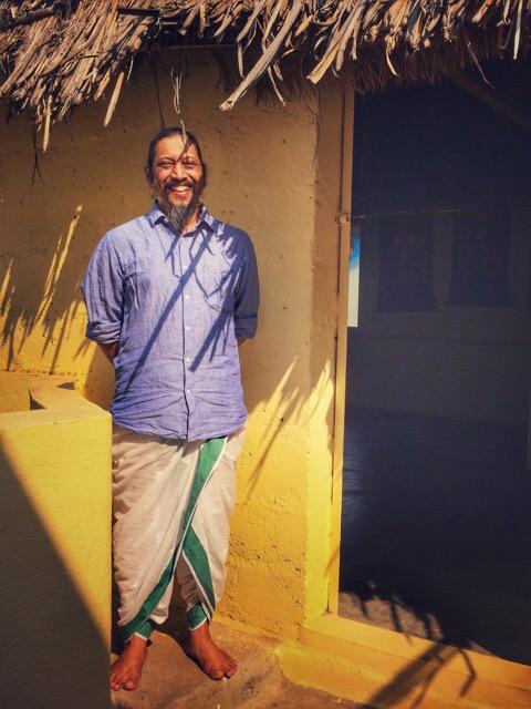 Kumar at the entry of Mumuksha meditation hall