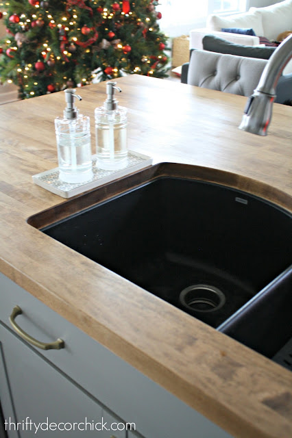 Black sink, wood countertops