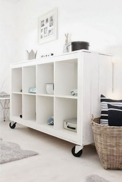 Ikea hack for Kallax shelving adding casters - found on Hello Lovely Studio