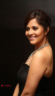 Telugu Anchor Actress Anasuya Bharadwa Stills in Strap Less Black Long Dress at Winner Pre Release Function  0038.jpg