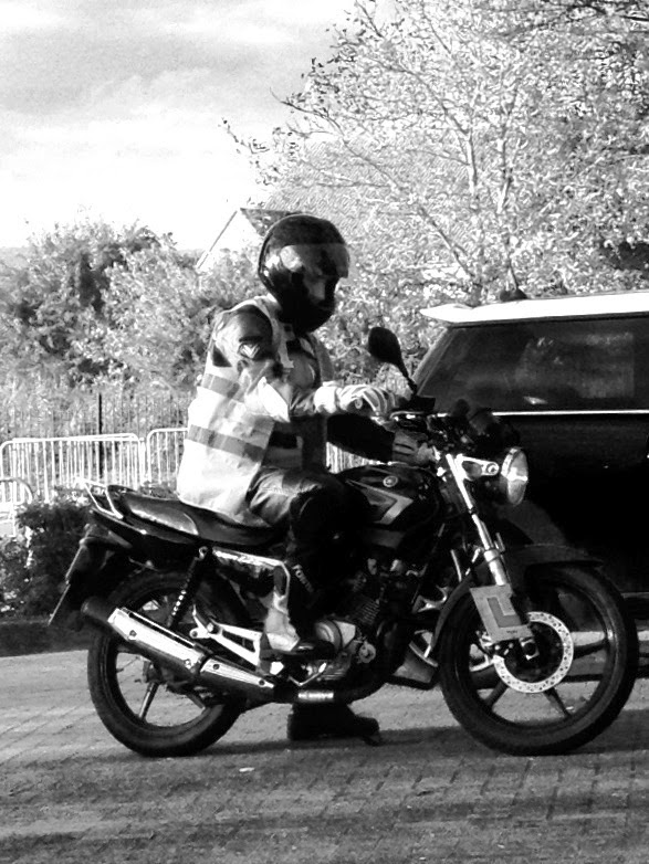 teen on 125cc motorbike in B&W