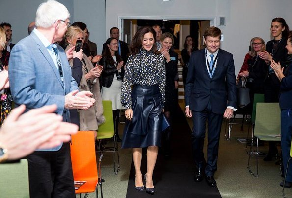 Danish Crown Princess Mary to the winner of the award, CSM's President Marianne Kirkegaard. Princess Mary wore leather skirt and print blouse