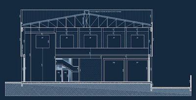 Seção transversal do projeto arquitetônico, salientando a mureta do mezanino sobre a escada de perfil aparente.