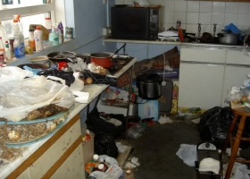 Messy kitchen looking like a disaster zone.