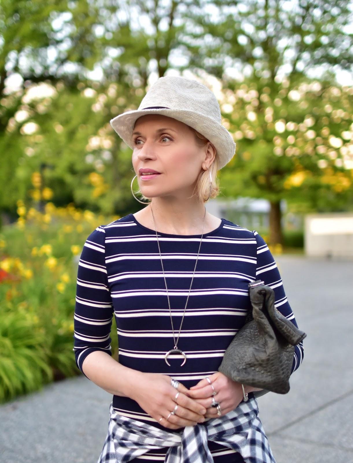 striped t-shirt dress, waist-tied plaid shirt, woven fedora