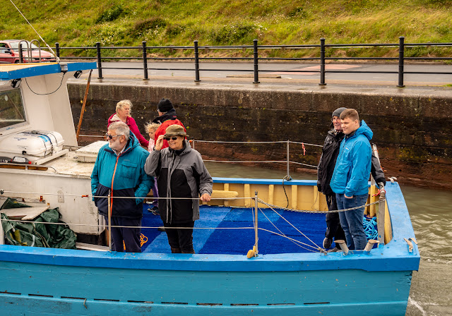 Photo of marina open day visitors wrapped up against the weather on Saturday