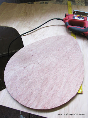 cutting wooden egg shape