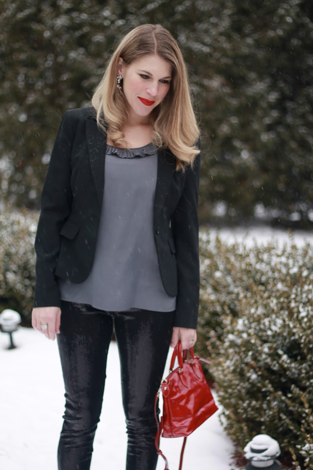 black sequined leggings with black blazer, grey blouse, red bag,