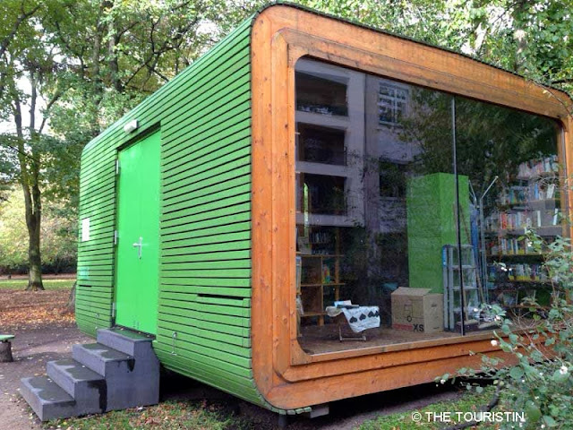 Cologne, Germany. Library Free, green tiny house. Stadtgarten