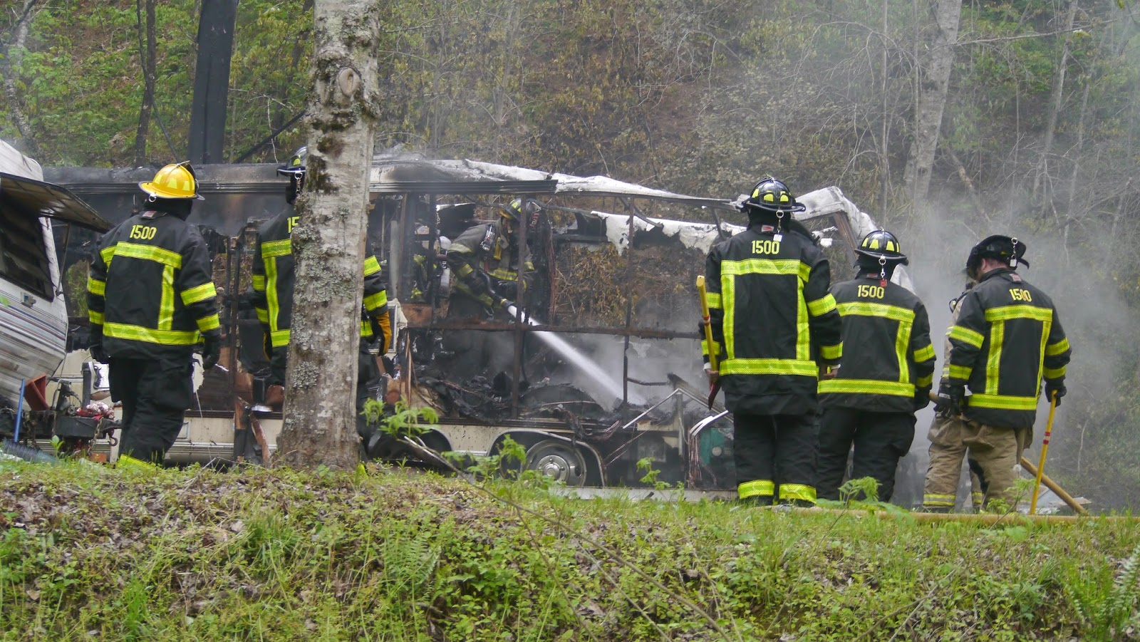 Firefighters conduct overhaul and salvage operations