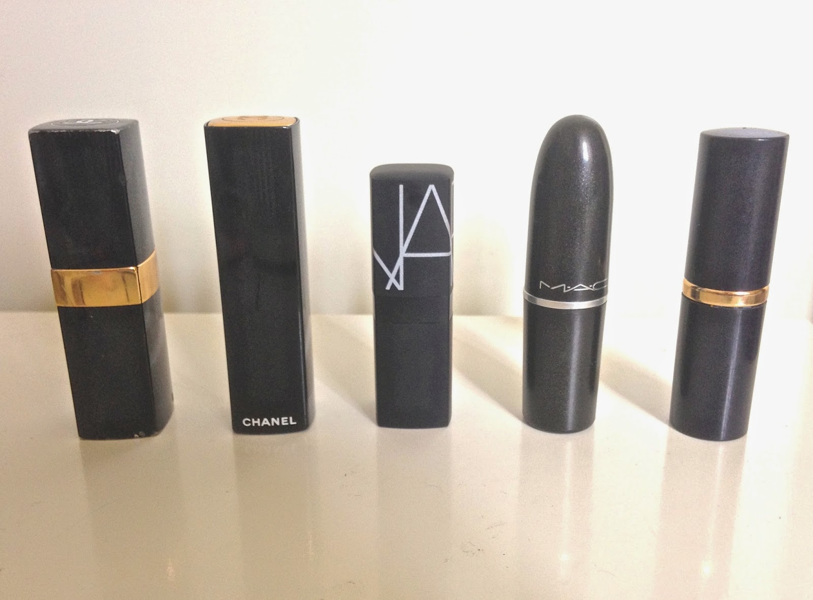 Image of 5 lipsticks, including Chanel, Nars, Mac cosmetics and Estée Lauder