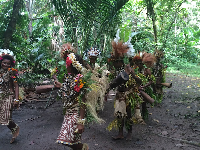 Bright colours, feathers from birds of paradise and flowers all form the costume for the sing-sing