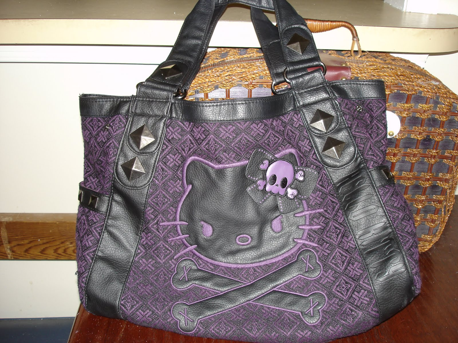 a890de206a23 Loungefly also has these shiny tote patent faux leather bags with embossed  detail that I want to buy. They come in different colors.